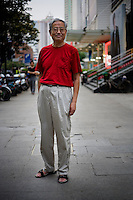 Jiweishun, retired, age 65, poses for a portrait in Nanjing. Response to 'What does China mean to you?': 'The place I was born and grew up.'  Response to 'What is China's role in the future?': 'A developing country. A peaceful society.'