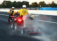 Sep 3, 2016; Clermont, IN, USA; NHRA safety safari crews clean up oil during qualifying for the US Nationals at Lucas Oil Raceway. Mandatory Credit: Mark J. Rebilas-USA TODAY Sports