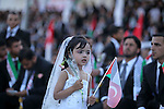A Palestinian girl waves Turkish flag during in a mass wedding ceremony in Gaza City, on May 31, 2015. Nearly 2000 Palestinian couples were married in a ceremony funded by the Turkish government and supported by the Hamas movement. Photo by Ashraf Amra