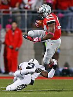 Ohio State Buckeyes running back Carlos Hyde (34) leaps over Penn State Nittany Lions cornerback Jordan Lucas (9) during the first half of the NCAA football game at Ohio Stadium in Columbus on Oct. 26, 2013. (Adam Cairns / The Columbus Dispatch)