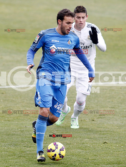 Getafe's Pedro Leon (l) and Real Madrid's James Rodriguez during La Liga match.January 18,2013. (ALTERPHOTOS/Acero) /NortePhoto<br />