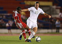 Action photo of Abby Wambach of United States and Wisin Dolce of Haiti. The US Women's National Team defeated Haiti 5-0 during the CONCACAF Women's World Cup Qualifying tournament at Estadio Quintana Roo in Cancun, Mexico on October 28th, 2010.