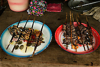 Bon Nuah, North Laos, August 13, 2007.A market foodstall stall, from left to right:.Fried fish, bird, rat, frogs, unidentified...