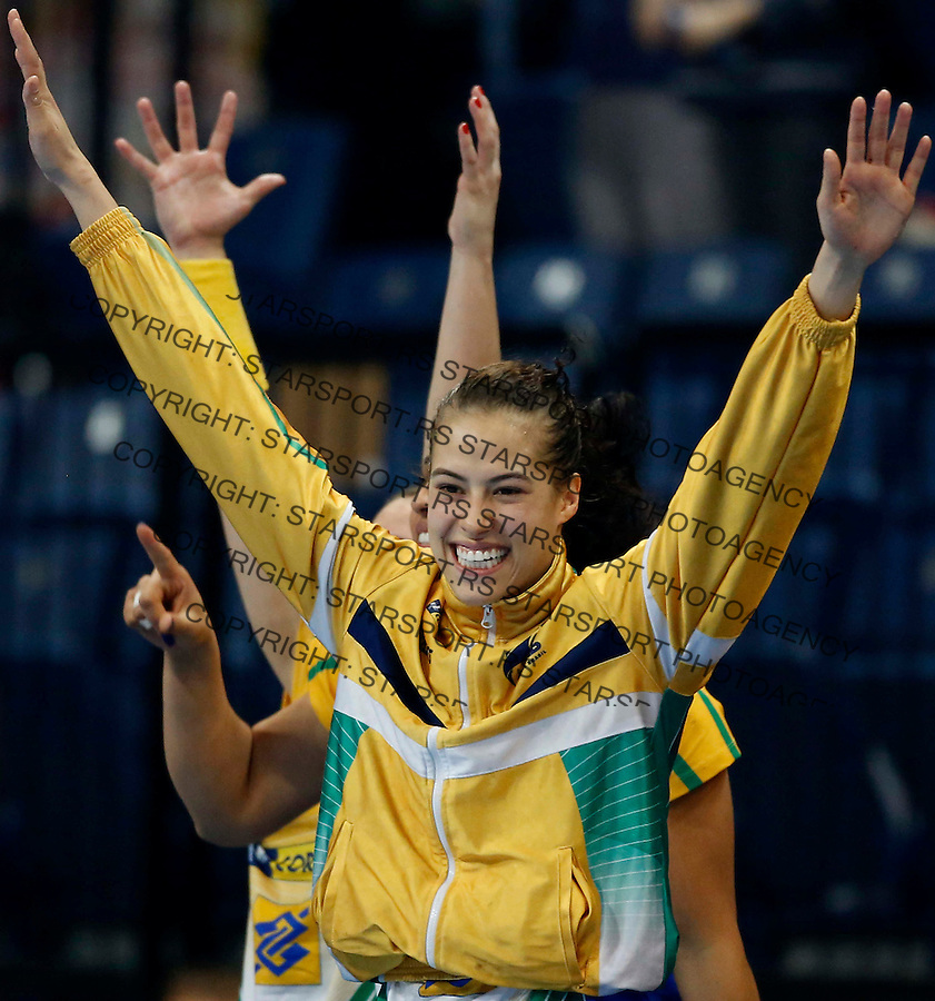 BELGRADE, SERBIA - DECEMBER 20:  Fernanda da Silva of Brazil celebrates during the World Women's Handball Championship 2013 Semi Final match between Brazil and Denmark at Kombank Arena Hall on December 20, 2013 in Belgrade, Serbia. (Photo by Srdjan Stevanovic/Getty Images)