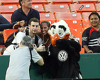 Talon mascot of D.C. United poses with fans during an international charity match against the national team of El Salvador at RFK Stadium, on June 19 2010 in Washington DC. D.C. United won 1-0.