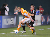 Houston Dynamo defender Andrew Hainault (31) shields the ball against DC United forward Danny Allsopp (9).  The Houston Dynamo defeated DC United 3-1, at RFK Stadium, Saturday September 25, 2010.