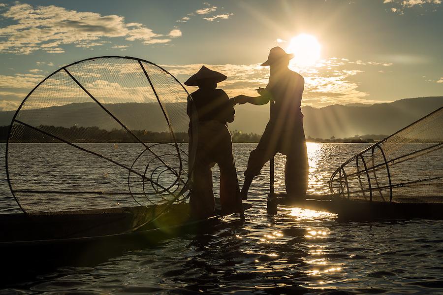 INLE LAKE, MYANMAR - CIRCA DECEMBER 2013: Fishermen taking a rest and smoking in Inle Lake