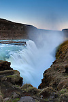 """The Hvítá River drops 69 feet (21 meters) into a narrow canyon at Gullfoss, one of the most visited waterfalls in Iceland. Gullfoss means """"golden falls."""""""
