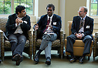 "Professors  Nitesh Chawla, and Jeff Schorey (right) listen to Edwin Michael (center) during Eva Luise Koehler's (not pictured) informal talk entitled, ""Rare Diseases: A Challenge for our Societies,"" to students and faculty of the University's Center for Rare and Neglected Diseases in the reading room at Jordan Hall. Photo by Barbara Johnston/University of Notre Dame"