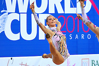 Anzhelika Savrayuk of Italian rhythmic group performs split leap during ribbon+rope on way to winning All Around gold at 2010 Pesaro World Cup on August 28, 2010 at Pesaro, Italy.  Photo by Tom Theobald.