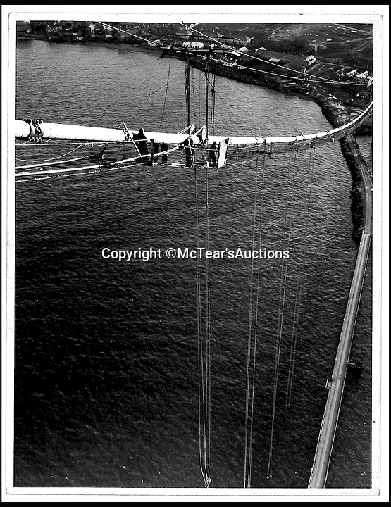 BNPS.co.uk (01202 558833)<br /> Pic: McTears/BNPS<br /> <br /> Hundreds of photos showing the building of the Forth Road Bridge have been found at a time when the troubled structure remains closed due to safety concerns.<br /> <br /> The incredible archive includes stomach-churning images of workers helping to fix the steel suspension cables into position 500ft above the Firth of Forth in Scotland.<br /> <br /> The photos was taken for engineering firm Sir William Arrol &amp; Co which produced and installed the steelwork for the bridge. They were retained by a member of staff who cleared out the officers when the firm went bust in the 1980s.