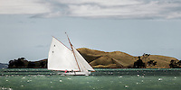 Classic yacht sailing past Browns Island, Waitemata Harbour, Auckland.