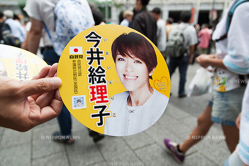 A member of staff distributes propaganda of Eirko Imai candidate of the Liberal Democratic Party for July's House of Councillors elections in Akihabara on July 9, 2016, Tokyo, Japan. Shinzo Abe, leader of the Liberal Democratic Party and Prime Minister of Japan delivered his last campaign speech before the July 10th House of Councillors elections. (Photo by Rodrigo Reyes Marin/AFLO)
