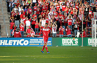 Chicago Fire forward Brian McBride (20) salutes the crowd as he exits the field for the last time for the Chicago Fire.  This was McBride's last home game for the Fire. The Chicago Fire tied DC United 0-0 at Toyota Park in Bridgeview, IL on Oct. 16, 2010.