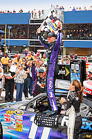19 June, 2011: Denny Hamlin celebrates winning the 43rd Annual Heluva Good! Sour Cream Dips 400 at Michigan International Speedway in Brooklyn, Michigan. (Photo by Jeff Speer :: SpeerPhoto.com)