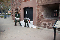 "National Parks Service employees sandbag Castle Clinton in Battery Park in the Zone A evacuation zone  prior to Hurricane Sandy, in New York on Sunday, October 28, 2012. In advance of the arrival of Hurricane Sandy New York will shut down the subways at 7 PM on Sunday and evacuate low lying ""Zone A"" areas including Battery Park City. In addition the schools will be closed on Monday. (© Richard B. Levine)"