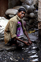 A man collects water in a pot on 21st Oct 2006. Water is in short supply and has to be collected from places such as this leading to infections and illness.