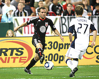 Brandon Barklage #24 of D.C. United controls the ball in front of Seth Sinovic #27 of the New England Revolution during an MLS match on April 3 2010, at RFK Stadium in Washington D.C.