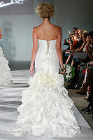 Model walks the runway in a Mariah by Katerina Bocci during the Wedding Trendspot Spring 2011 Press Fashion, October 17, 2010.