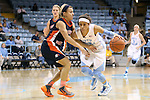 30 October 2013: North Carolina's Jessica Washington (right) and Carson-Newman's Lacy Miller (left). The University of North Carolina Tar Heels played the Carson-Newman College Eagles in a women's college basketball exhibition game at Carmichael Arena in Chapel Hill, North Carolina. UNC won the preseason game 111-50.