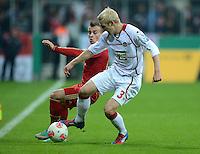 FUSSBALL  DFB POKAL       SAISON 2012/2013 FC Bayern Muenchen - 1 FC Kaiserslautern  31.10.2012 Xherdan Shaqiri (li, FC Bayern Muenchen) gegen Leon Jessen (1. FC Kaiserslautern)