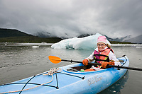 Children enjoy sea kayaking in Prince William Sound, southcentral, Alaska.