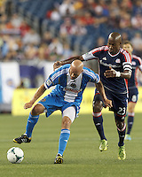 Philadelphia Union forward Conor Casey (6) controls the ball as New England Revolution defender Jose Goncalves (23) defends. In a Major League Soccer (MLS) match, the New England Revolution (dark blue) defeated Philadelphia Union (light blue), 5-1, at Gillette Stadium on August 25, 2013.