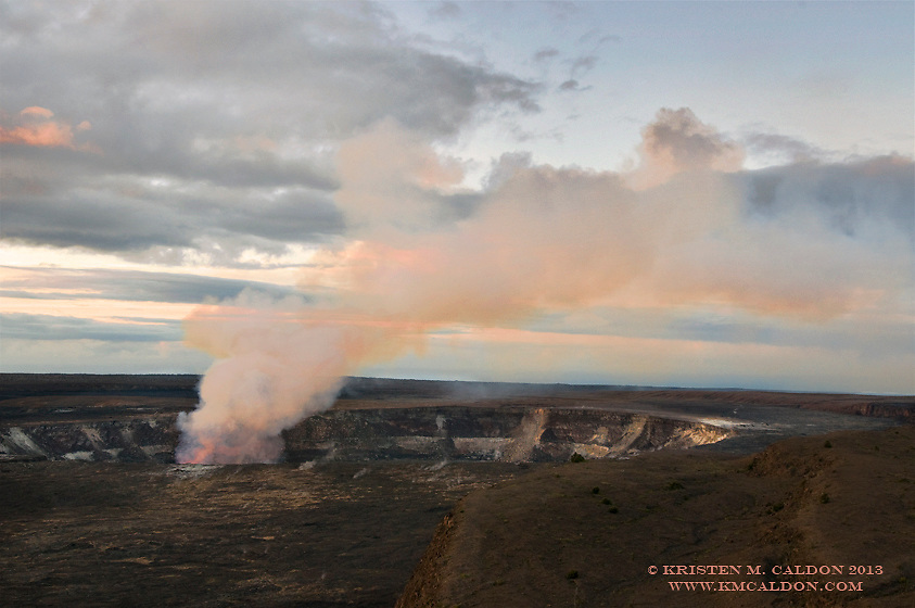 Halema'uma'u Crater glows in predawn light.  Kilauea is a very active volcano that can be visited within the Park.<br />