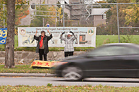 Falun Gong members practice an exercise by a major Ottawa artery in front of a protest sign Wednesday September 29, 2010. Falun Gong (alternatively Falun Dafa) is a system of beliefs and practices founded, and now banned in China.