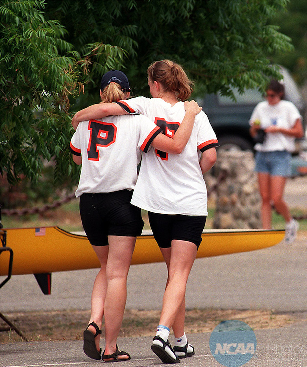 1 June 97: Lexie Pitney (L) and Kristin Bartges (R) of Princeton console each other after a 5th place finish in the Varsity 4 category at the Women's Division 1 Rowing Championships at the Lake Natoma Aquatic Center in Rancho Cordova, CA. The University of Washington claimed the championship. Jose Luis Villegas/NCAA Photos.