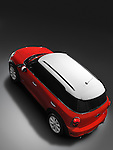 High angle view of a red with white top 2011 Mini Cooper Countryman All4 crossover car isolated with clipping path on gray background