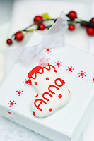 A simple present has been personalised with a Fimo label in the shape of a Christmas stocking