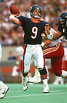 CHICAGO,IL-1987:  NFL quarterback Jim McMahon of the Chicago Bears drops back to pass during an NFL game at Soldier Field in Chicago Illinois.  McMahon played for the Chicago Bears from 1982-1988.  (Photo by Ron Vesely)