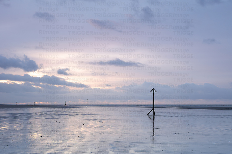 Calm seascape with flat sea and evening sky