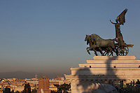 The goddess Victoria riding on a quadriga, 1908 by Carlo Fontana and Paolo Bartolini, equestrian statue at the top of the Monumento Vittorio Emanuele II (Monument to Victor Emmanuel II). Rome, Italy, cityscape in the background. Picture by Manuel Cohen