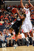 CHARLOTTESVILLE, VA- DECEMBER 6: Ryan Pearson #24 of the George Mason Patriots shoots in front of Mike Scott #23 of the Virginia Cavaliers during the game on December 6, 2011 at the John Paul Jones Arena in Charlottesville, Virginia. Virginia defeated George Mason 68-48. (Photo by Andrew Shurtleff/Getty Images) *** Local Caption *** Mike Scott;Ryan Pearson