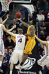 Wyoming's  Wyoming's Hank Hankerson drives past Northern Iowa's Matt Bohannon (5) and Paul Jesperson (4) in the 2015 NCAA Division I Men's Basketball Championship March 20, 2015 at the Key Arena in Seattle, Washington.   Northern Iowa beat Wyoming 71 to 54.   ©2015.  Jim Bryant Photo. All Rights Reserved.
