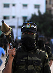 Masked militants of Al-Nasser brigades, the military wing of the Popular Resistance Committees, march with weapons during an anti-Israeli protest in Gaza City March 31, 2014. Photo by Khaled al-Sabbah