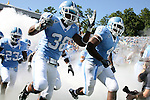 02 September 2006: UNC's Jermaine Strong (38) and Bobby Rome (4) race onto the field before the game. The University of North Carolina Tarheels lost 21-16 to the Rutgers Scarlett Knights at Kenan Stadium in Chapel Hill, North Carolina in an NCAA Division I College Football game.