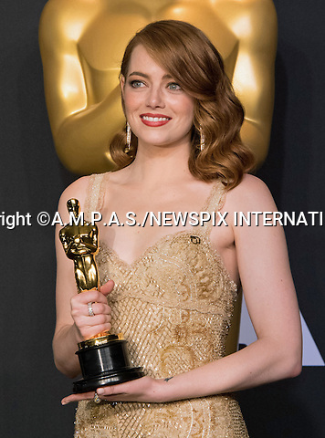 26.02.2017; Hollywood, USA: EMMA STONE<br /> Clutching their awards - The OSCARs winners, backstage with their awards at the 89th Annual Academy Awards at the Dolby&reg; Theatre in Hollywood.<br /> Mandatory Photo Credit: &copy;AMPAS/NEWSPIX INTERNATIONAL<br /> <br /> IMMEDIATE CONFIRMATION OF USAGE REQUIRED:<br /> Newspix International, 31 Chinnery Hill, Bishop's Stortford, ENGLAND CM23 3PS<br /> Tel:+441279 324672  ; Fax: +441279656877<br /> Mobile:  07775681153<br /> e-mail: info@newspixinternational.co.uk<br /> Usage Implies Acceptance of Our Terms &amp; Conditions<br /> Please refer to usage terms. All Fees Payable To Newspix International