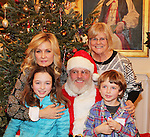 Santa Claus with Another World's and Blue Bloods Amy Carlson - daughter Lyla - son Nigel - mom Beth - Hearts of Gold links to a better life celebrates Christmas with a party #3 for mothers and their children on December 22, 2016 in New York City, New York with arts and crafts, a great turkey dinner with all the goodies and then the children met Santa Claus and had a photo with him as he gave them gifts. (Photo by Sue Coflin/Max Photos)