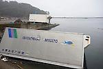 Photo shows container trucks swept into the water following the March 11 tsunami which wrecked the Kyubun beach area on the Oshika Peninsula, Ishinomaki City, Miyagi Prefecture, Japan on 25 May, 2011..Photographer: Robert Gilhooly