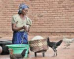 A woman in Dundube Kadambo, in northern Malawi, prepares corn for cooking.