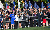 Guests participate in the singing of the US national anthem  as United States President Barack Obama hosts an Official State Welcome ceremony for Pope Francis on the South Lawn of the White House in Washington, DC on Wednesday, September 23, 2015.  <br /> Credit: Chris Kleponis / CNP