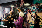Senator Barack Obama, Democratic presidential candidate, posing for pictures in front of a Tulane basketball mural after a  campaign speech. New Orleans, Louisiana, February 7, 2008