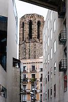 Spain, Barcelona. La Rambla is a street in central Barcelona. Tower of the Santa Maria del Pi church.