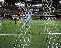 Bill Hamid (28) of D.C. United  is beaten by Juan Agudelo (17)of the New York Red Bulls on the fourth goal during an MLS match at RFK Stadium, in Washington D.C. on April 21 2011. Red Bulls won 4-0.