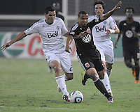 D.C. United forward Charlie Davies (9) goes against Vancouver Whitecaps FC defender Michael Boxall (2). D.C. United defeated The Vancouver Whitecaps FC 4-0 at RFK Stadium, Saturday August 13 , 2011.