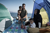 Iranian family camping out in the street near the promenade. Kos, Greece. Sept. 5, 2015