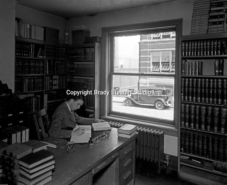 Pittsburgh PA: Student working on a project at the library, Duquesne University - 1932
